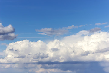 Blue sky with white clouds. Summer background.