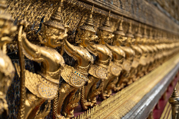 The golden garuda sculptures in church at Wat Phra Kaew Templa in Bangkok,Thailand.