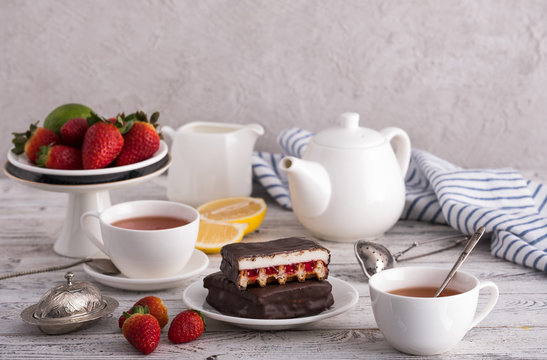Chocolate cakes with fruits and tea for breakfast.