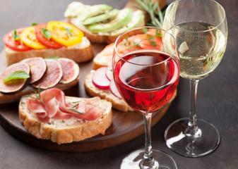 Brushetta or spanish tapas set with wine