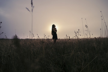 Lost beautiful girl in the field of fog