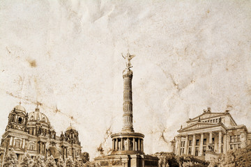 A composition of the famous landmark of Berlin in Germany on an old vintage crumpled paper with space for text at the top. Vintage, grunge, old, retro postcard style photo.