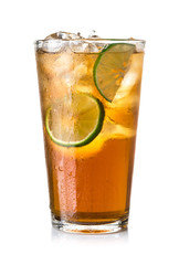 Glass of ice tea with lime on white background