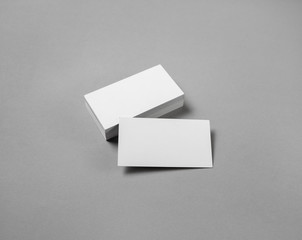 Blank white business cards on gray paper background. Template for ID with plenty of copy space.