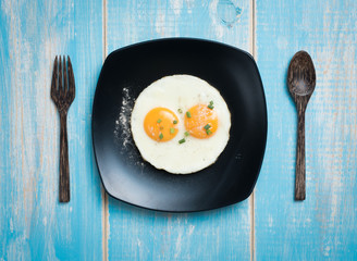 Printed kitchen splashbacks Egg Fried eggs in a plate on a table,top view