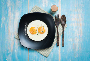 Aluminium Prints Egg Fried eggs in a plate on a table,top view