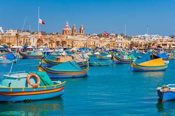 Colourful Boats in Harbour of Marsaxlokk Malta at springtime