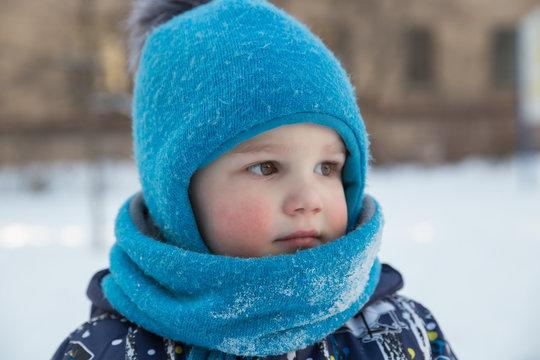 Portrait of boy in winter outdoors