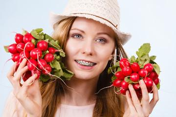 Happy woman giving radish