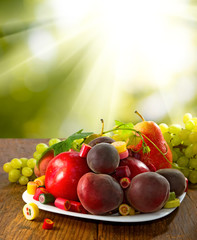 Fototapete - different fruits and sweets on wooden table