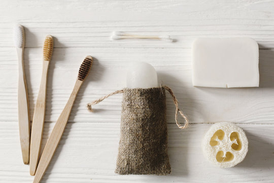 sustainable lifestyle concept. zero waste flat lay. bathroom essentials, plastic free items. eco natural bamboo toothbrush, crystal deodorant,luffa, coconut soap,ear sticks