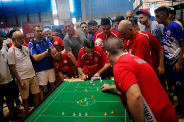 A Belgium player stops a ball of an Austrian player during their match of the Open category during the Table Football World Cup in the British overseas territory of Gibraltar