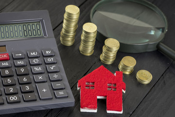 Real estate  and Mortgage Concept. Money , House , Magnifying Glass and Calculator.