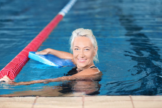 Sportive senior woman in indoor swimming pool
