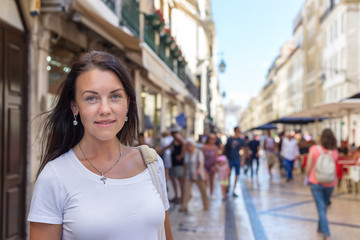 Portrait of a girl walking along the busy streets Augusta of Lisbon.