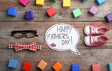 Flat lay composition with words HAPPY FATHER'S DAY, shoes and accessories on wooden background