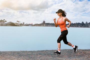 Sporty female jogger morning exercise on seaside on grass. vintage tone