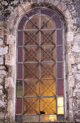 rusty window of old stone building