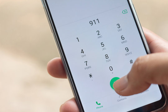 Emergency and urgency, dialing 911 on smartphone screen.