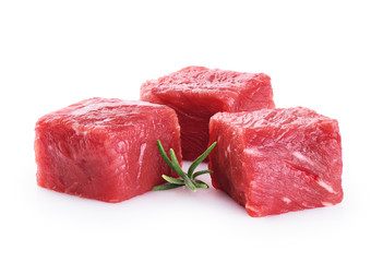 Fresh raw beef cubes and rosemary isolated on white background.