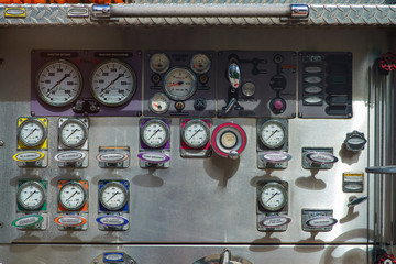 Close-up fire truck equipment detail. Fire control panel, dials and dashboard