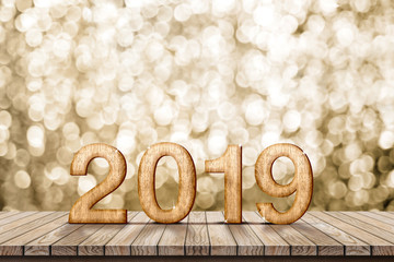2019 happy new year wood number (3d rendering) on wood table with sparkling gold bokeh wall,leave space for display or montage of design or content.
