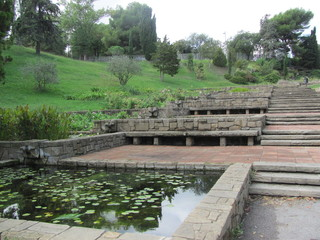 Beautiful scenery with southern trees and plants, park in Barcelona