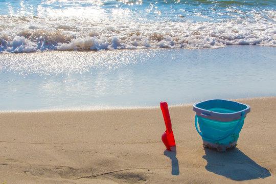 Children's bucket and scoop in the sand