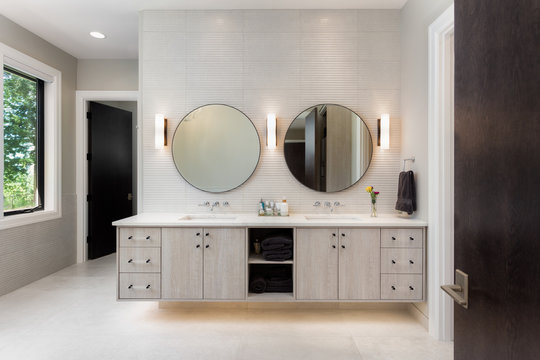 Elegant bathroom in new luxury home with two sinks and two mirrors