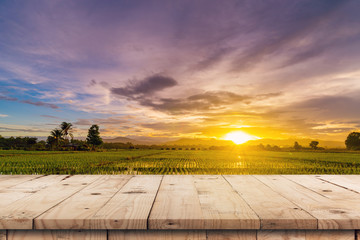 Foto op Plexiglas Lavendel Rice field sunset and Empty wood table for product display and montage.