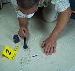 Footprint found on tile in the bathroom at the crime scene. Found with help black powder and brushes