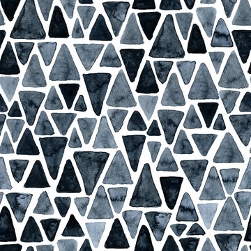 Seamless hand drawn watercolor pattern of triangles. Abstract monochrome design.