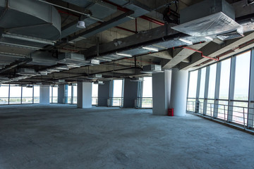 Unfinished interior of business center under construction in grey colours