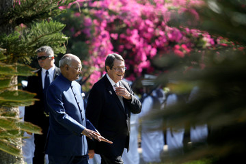 Cypriot President Nicos Anastasiades and Indian President Ram Nath Kovind talk during a welcome ceremony at the Presidential Palace in Nicosia