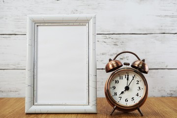 vintage alarm clock and space photo frame