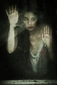 ghostly woman portrait behind old wooden window