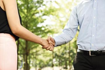 Businessman making handshake with a businesswoman