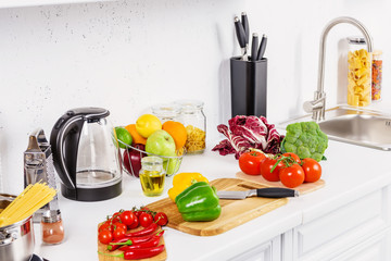 ripe appetizing vegetables on kitchen counter in light kitchen