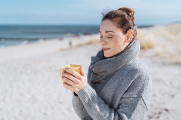 Young woman enjoying a relaxing cup of coffee
