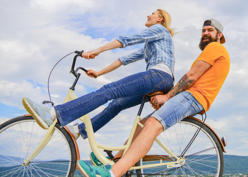 Man and woman rent bike to discover city. Bike rental or bike hire for short periods of time. Couple with bicycle romantic date sky background. Couple in love date outdoors cycling. Date ideas
