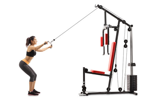 Young woman exercising on a fitness machine