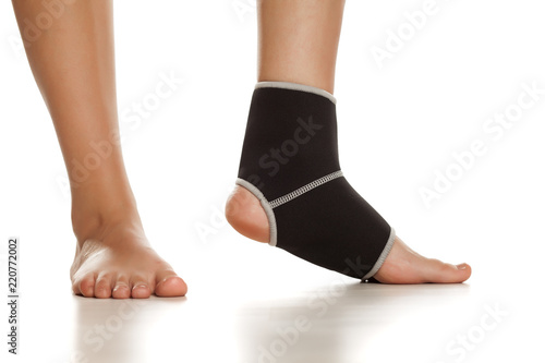 db9ce0d7ac Female leg with Supportive Orthopedic Wrist on the ankle on white background