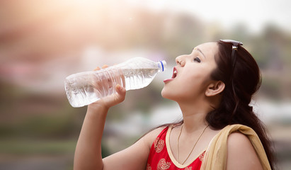 Young woman drinking water.