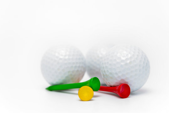 golf ball and tees on white background