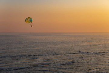 Printed roller blinds Water Motor sports Mediterranean sea and a motor boat with a parachute in Dubrovnik, Croatia - sunset orange light