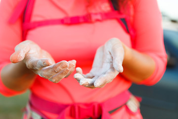 Photo of woman climber with talc on hands