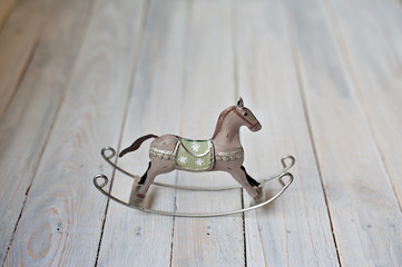 Old rocking horse on a rustic country backdrop