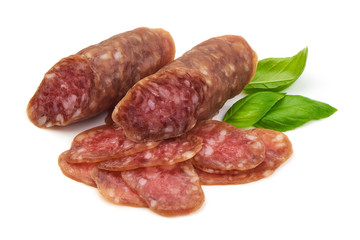Smoked sausage with thin slices and green basil leaves, isolated on white background