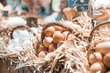 Fresh rooster eggs in the basket in organic store