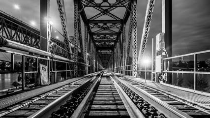 Patullo Bridge, Surrey, British Columbia, Canada. Long exposure of the bridge over the water. Black and White picture of the Train Bridge.